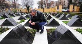 Romanians mark somber anniversary